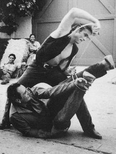 "James Dean on the set of Giant with cowboy actor Bob Hinkle from (Brownfield Texas) who was technical/dialogue director/coach, and advising the likes of James Dean, Rock Hudson, and others on how to "" talk Texan "" also taught Dean some rope tricks"