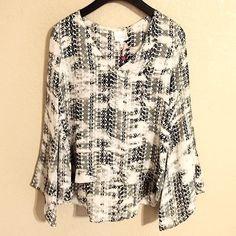 """NWT Parker Silk Printed Rita Blouse ❗️Reduced from $90❗️Brand new with tags authentic Parker """"Rita"""" blouse. Belled sleeves and a tiered high/low hemline bring alluring flutter and volume to a soft V-neck top. Black and white graphic print. Size XS. Approx 22"""" front length; 27"""" back length. Lined. 100% silk. Dry clean. Model photos credit Lyst, both are the same style but slightly different  prints than the one for sale. ❌No trades❌Price firm unless bundled. Parker Tops Blouses"""