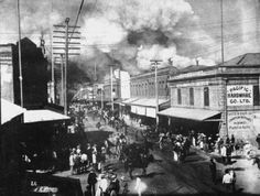 2. A fire burns in Honolulu's Chinatown in 1900. The fire was set to destroy homes suspected of being infected by the bubonic plague.