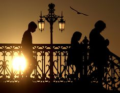 Brighton : The Place To Be.with children 2 Silhouette Photography, Sunset Silhouette, Street Lamp, Urban Life, Sunset Photography, Exterior Lighting, Brighton, Lighthouse, Interior And Exterior