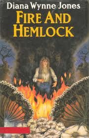 i think this cover is close to the photo that Polly has in the book.  Fire and Hemlock by Diana Wynne Jones.