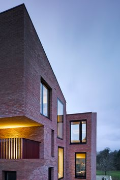 Three mono-pitched brick buildings combine to form this house in Belfast by Hall McKnight