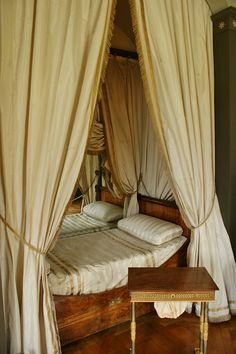 'before disappearing behind a large screen in the adjoining sitting room, which he had turned into his own little sleeping area.' This pic - Napoleon's bed at Chateau Malmaison