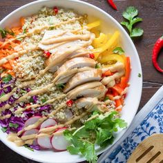 Thai Chicken Quinoa Salad, packed with fresh veggies and topped with a creamy peanut dressing!