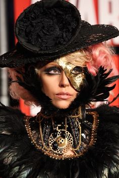 At the 2009 MTV Video Music Awards, Gaga found the time to completely change her outfit four times. But what we are really living for is this Jean Paul Gaultier steam punk-inspired moment, complete with a gold mask, pink wig and exaggerated smokey eye. Lady Gaga 2009, Lady Gaga The Fame, Kanye West, Moda Lady Gaga, Jean Paul Gaultier, Lady Gaga Birthday, 31st Birthday, Birthday Wishes, Fotos Lady Gaga
