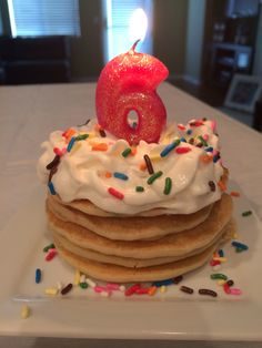 Funfetti mini pancakes, lotsa whipped cream, sprinkles & pretty candle for birthday morning surprise.