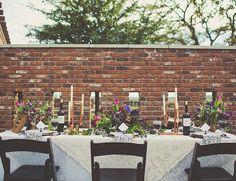 purple wedding inspiration // copper candlesticks + purple florals + lace tablecloths