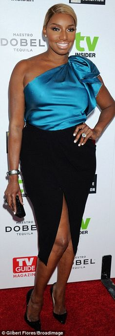 Beauty in blue: NeNe Leakers sparkled in a shiny blue blouse and black pencil skirt