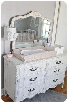 White Painted Vintage Dresser Turned Into Nursery Changing Area