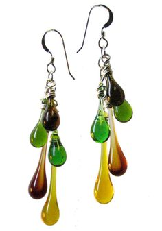A tumbling cascade of glass droplets ranging from Kelly Green to Honey and Brown, these earrings include glass recycled from green and brown beer bottles.