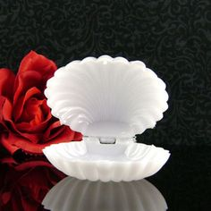 """Plastic White Clam Shell Favors come 12 per package (.25 cents). Each White Plastic Clam Shell measures approximately 2 1/2"""" wide x 3/4"""" deep and will make great homemade wedding favors!"""