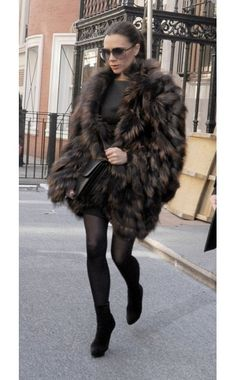 Victoria Beckham in Victoria Beckham dress, Fendi faux fur coat, Celine bag, Christian Louboutin boots