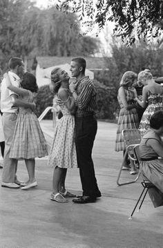 Teenager Suzie Slattery (C) dancing w. boyfriend Ted Sten. 1959