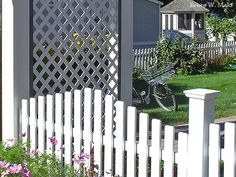 Simple picket fence with rising and falling tops of pickets.