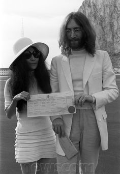 Beatles singer John Lennon and his new bride Yoko Ono holding their marriage certificate after their marriage marries Yoko Ono March 1969.