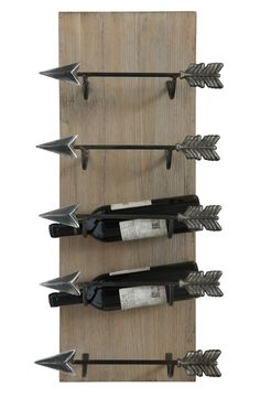 Add rustic edge to the interior décor while flaunting the drink of choice with this arrow-themed wine rack that can hold up to five bottles.