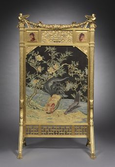 """1878-1880 American Fire screen at the Cleveland Museum of Art, Cleveland - From the curators' comments: """"The most striking aspect of this piece is the painted and gilded embossed panel of birds and flowers which was almost certainly made in Japan. The design of the screen as a whole seems to have been predicated on the use of this decoration."""""""