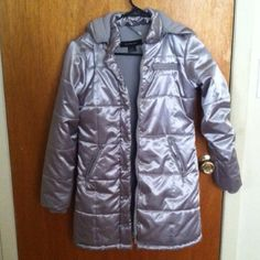 REDUCED‼️‼️‼️‼️CALVIN KLEIN WINTER JACKET🎄⛄️❄️🎄 Nice girls gray silver Calvin Klein jacket size medium. The part to hang the coat needs to be reattached. There is a name faintly written on the interior which you can seek removal. Otherwise this is a VERY nice coat. Great price for this designer with minor imperfections. Kids jacket. Girls winter coat. Girls winter jacket. Girls jacket. Kids jacket. Girl winter coat. Kids jacket size medium. Small signs of wear. Warm just in time for…