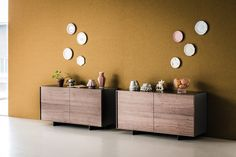 A solid wood frame seameless sideboard available in White, Graphite lacquered wood with doors and drawers in Canaletto Walnut or Burned Oak. The Oxford featured feet in black embossed painted steel and clear glass�internal shelves.