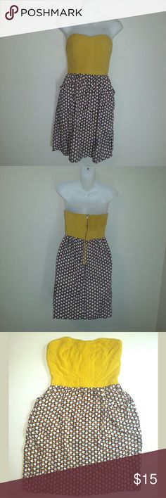 """Xhilaration Sleeveless Apple Print Mini Dress Excellent gently loved condition. Has one tiny hole on the front near where the bodice meets the skirt, pictured. Yellow-gold bodice with a cute navy background, white apple print skirt with yellow and orange leaves. Dress features pockets and a back zipper. 100% Rayon Measurements laying flat Chest 13"""" Waist 12"""" Length 28""""  Feel free to ask any questions, request additional measurements or additional photos.  Please submit offers through the…"""
