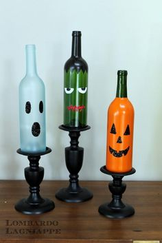 DIY Tutorial: DIY Halloween / DIY Halloween Wine Bottles - Bead&Cord. What a crafty way to decorate the house for Halloween! Throw some candles in the bottle for night time illumination.