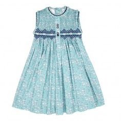Description: An impecabbly designed smock dress that has a slight ruffle to the collar with navy ric-rac trim. This classic print features hand sewn embroidery across the chest up to the neckline. Pink Dresses For Kids, Girls Smocked Dresses, Little Girl Dresses, Long Skirt Top Designs, Dress Designs, Punto Smok, Stitching Dresses, Smocks, Kids Frocks Design