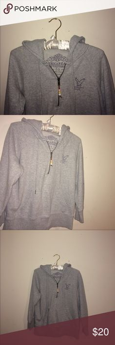 !American Eagle Outfitters Hoodie w/ Beads on Zipp This is a grey hoodie with a zipper that has cute beads connected to it in pink yellow and white! It's super comfy and cute!😍 It's a large but could fit a small and medium if needed! American Eagle Outfitters Tops Sweatshirts & Hoodies
