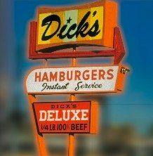Taking the First Bite of a Dick's Burger