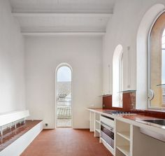 Arquitectura G Tiled Kitchen in Spain