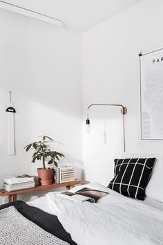 bedroom | bed | industrial | modern | minimal | white | simple | paris map | plant | books | decor