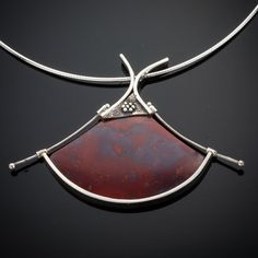 Necklace   Creek Reflections (Bruce and Darlene Hartman).  Red Agate with sterling silver.