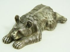 """IMPERIAL RUSSIAN SILVER BEAR FIGURE w RUBY EYES - Russian silver recumbent bear figure with cabochon cut ruby stones set in eyes. Has town marks and 84 silver purity marks to bottom. Also holds Julius Rappoport's """"I.P."""" workmaster mark to bottom."""