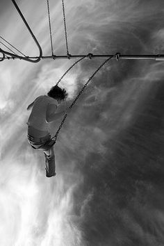 Infinity | swinging | playground | up up and away | heights | freedom | fun | clouds and sky | higher | black & white photography
