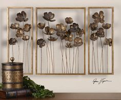 Metal Tulips, S/3 - This set of decorative wall art is made of hand forged metal finished in antiqued gold leaf with a charcoal gray wash. Sizes: Sm-10x27x4, Lg-20x27x4.  Designer: Gracec Feyock.