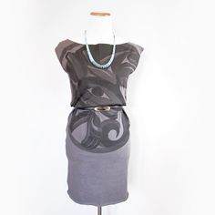 This tunic was designed by Tahltan artist Alano Edzerza and features a wolf design in grey. This tunic dress looks great with tights or leggings an...
