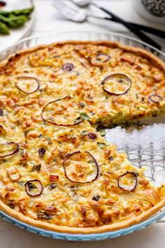 Savory vegetarian onion tart recipe with leeks, shallots, yellow onions and green onions. Slow-cooked to bring out their sweetness, Crème fraische, thyme. Tart Recipes, Rice Recipes, Vegetarian Recipes, Caramelised Onion Tart, Caramelized Onions, Quiches, Savory Tart, Dinner Is Served, Rice Krispie Treats