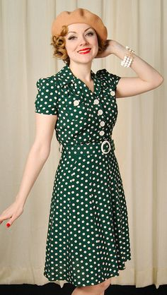 """1940s dress: Trashy Diva writes, """"With cream polka dots on a green background, you'll love the Sweetie Dress if you are a fan of glamorous WWII styling. This early 1940s inspired shirtwaist dress details creams buttons."""