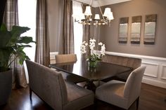 The dining room wall color is called Spalding Gray by Sherwin Williams. The trim is called Ivory Lace also by Sherwin Williams.