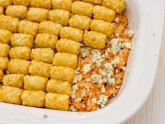 Buffalo Chicken Tater Tot Casserole - 4 cooked chicken breasts, diced (about 2 lbs); ¾ c butter; 1 c hot sauce; ½ tsp garlic powder; ½ tsp salt; ⅓ c crumbled blue cheese; 1 pkg (1kg) Tater Tots; 1 c grated cheddar cheese; ¾ c diced celery