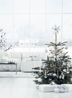 All white interior at Christmas. Sweden.