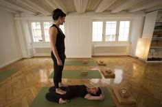 Isabelle assisting Suzanne in deepening Supta Virasana at yogagarage, Zurich.