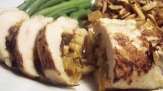 A date, apricot, and cayenne pepper stuffing fills these baked chicken breasts.