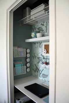 Office in a closet. For one of the bedroom side closets?