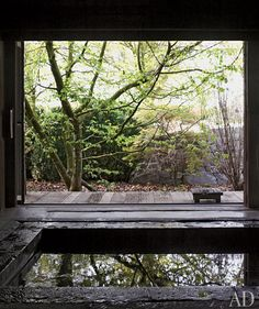 The minka serves as a tranquil retreat for baths, simple meals, and massages; its sliding door opens wide to the garden.