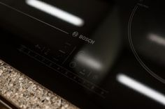 Modern Oak - Sheffield Sustainable Kitchen recycled glass worktop with Bosch induction hob