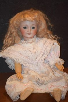 Here is a beautiful French Doll. She is marked with the JUMEAU and incised SFBJ 301 PARIS it is also incised with 2 with 27 underneath. The doll