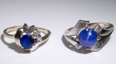 Lot 275: 14k White Gold, Semi-Precious Gemstone and Diamond Rings; Two rings, one having a round cut cabochon blue star sapphire, the other having a round cut blue spinel, both adorned with diamond chips