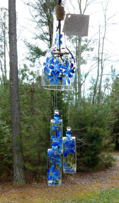 """bottle crafts wind chimes Wind Chime, """"Blue Belle"""" , made from recycled wine bottle - fashioned into a Wine-Chime! Glass Bottle Crafts, Wine Bottle Art, Diy Bottle, Cutting Glass Bottles, Recycled Wine Bottles, Recycled Glass, Diy Wind Chimes, Custom Bottles, Bottles And Jars"""