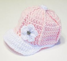 This easy crochet baseball cap is perfect for those hot summery days. Throw on your favorite motifs, flowers, or letters and customize it for your favorite team. Directions for a five petal flower are included in the pattern. Crochet Baby Blanket Beginner, Crochet Baby Hat Patterns, Baby Girl Crochet, Crochet Baby Hats, Crochet Beanie, Booties Crochet, Bonnet Crochet, Crochet Cap, Free Crochet