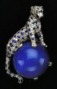 Cartier diamond and sapphire panther pin owned by the Duchess of Windsor. The round cabochon star sapphire weighs 152.35 carats.